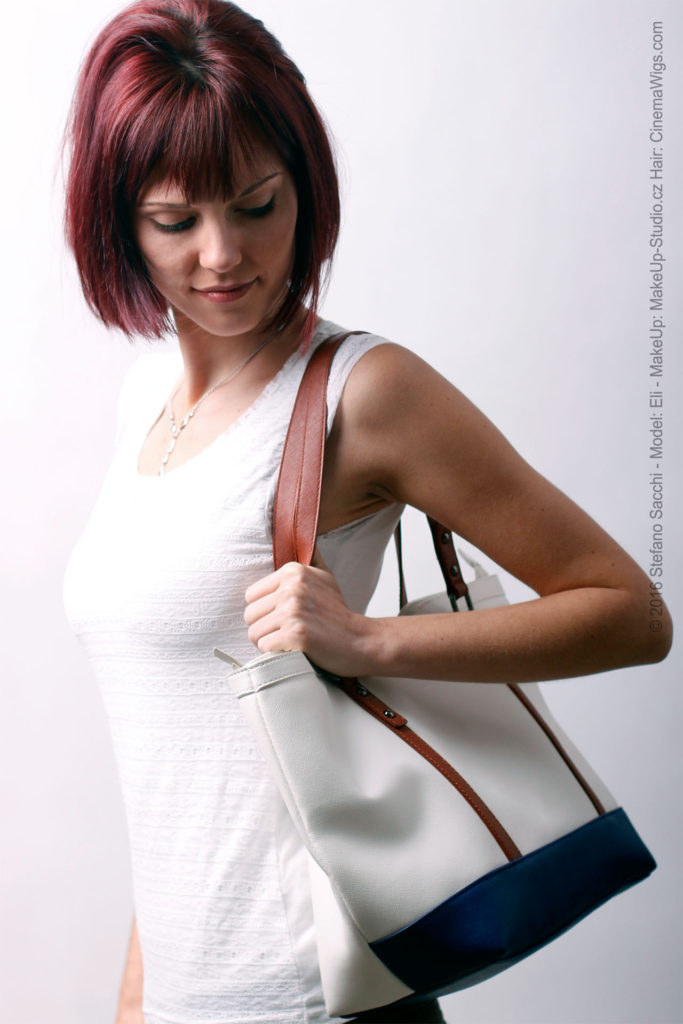 model with a white leather bag